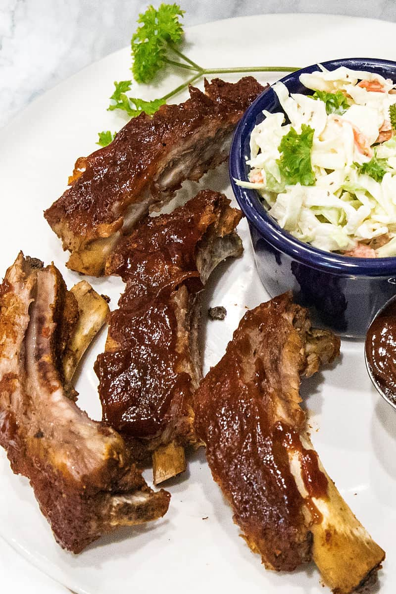 Best Instant Pot Ribs are moist, fall off the bone ribs made easy in the pressure cooker. In just three easy steps and under 40 minutes, they're keto, paleo and definitely family-friendly. #mustlovehomecooking