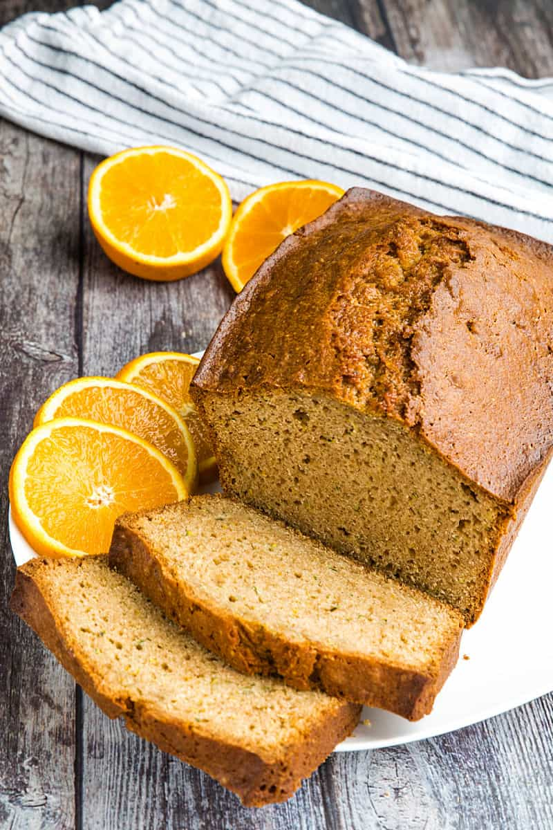 Best Ever Orange Zucchini Bread is simple and easy to make from scratch! This moist quick bread is made healthy with fragrant orange zest, fresh zucchini and applesauce. #mustlovehomecooking