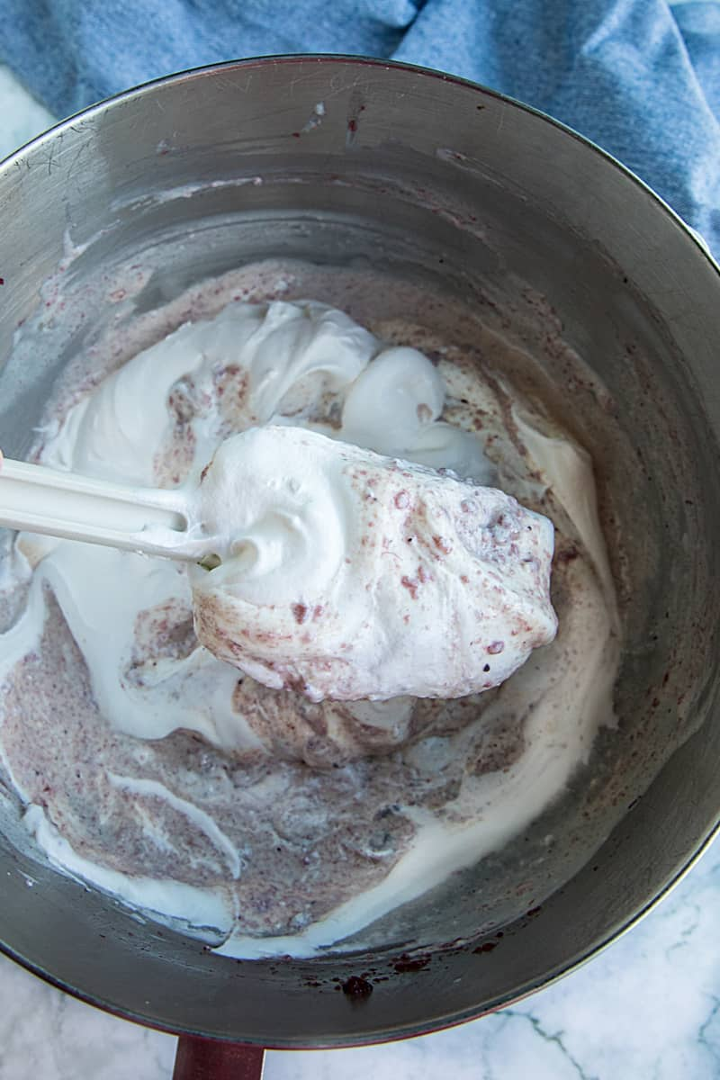 folding in whipped topping with rubber spatula in metal bowl #mustlovehomecooking